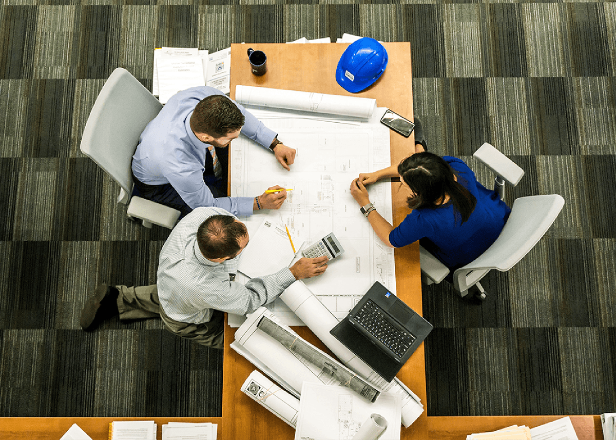 top-down view of people working at a table