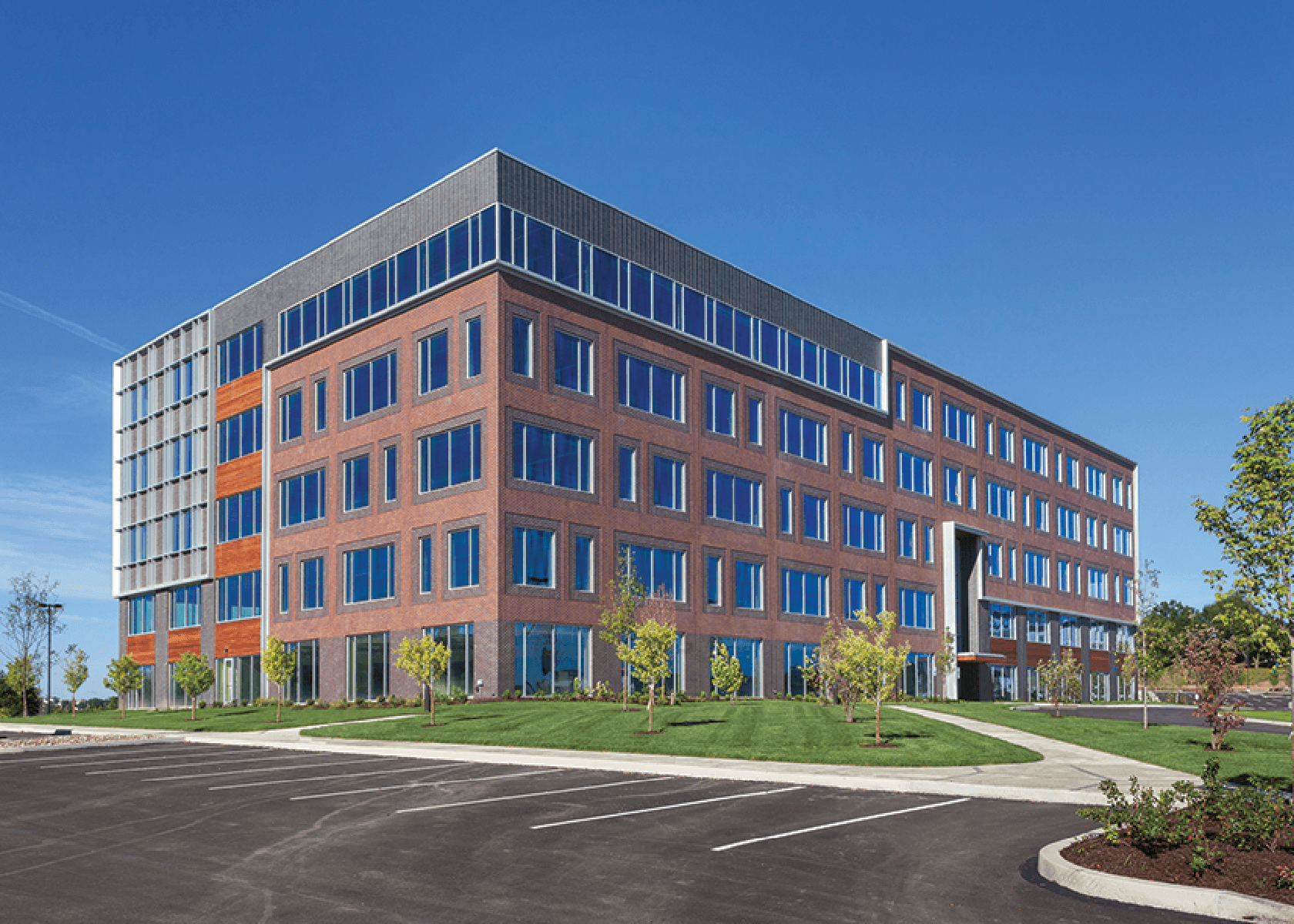 Exterior of Zenith Ridge office building-5 story brick building with wood accents,
