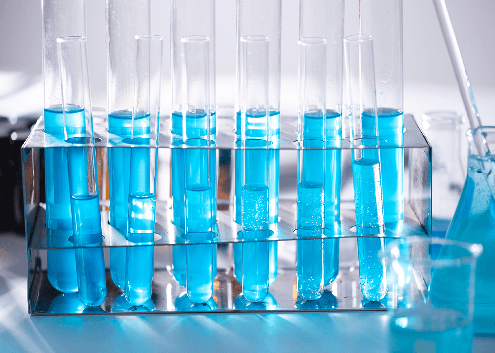 medical science test-tubes with blue liquid