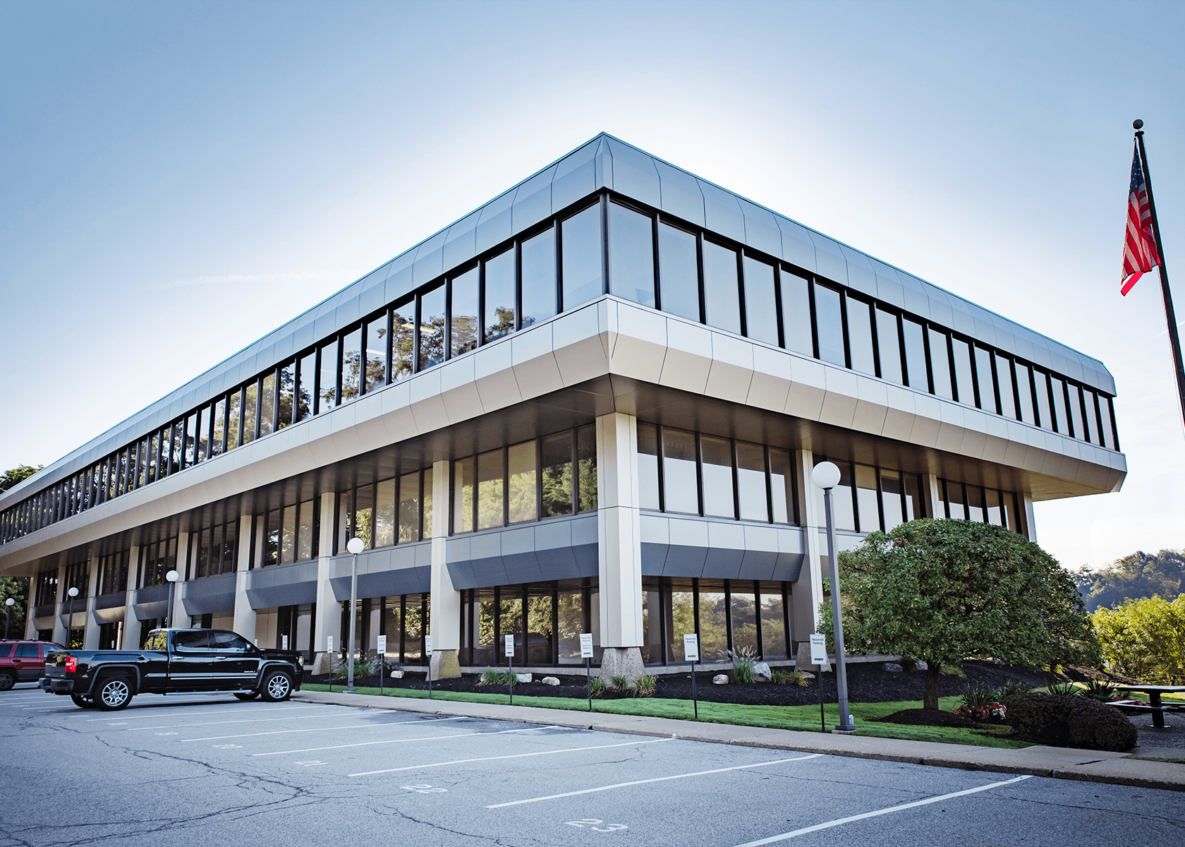 Exterior of Foster 0 office building-three story tan building with large windows