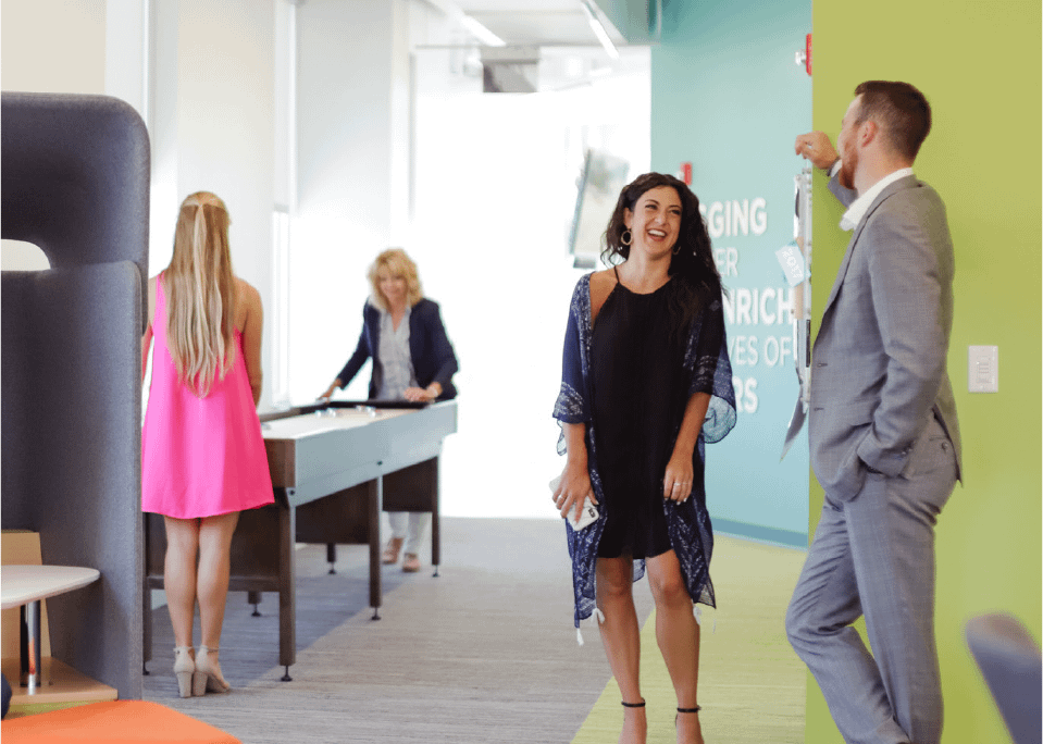 Burns Scalo team members socializing in a collaborative office space