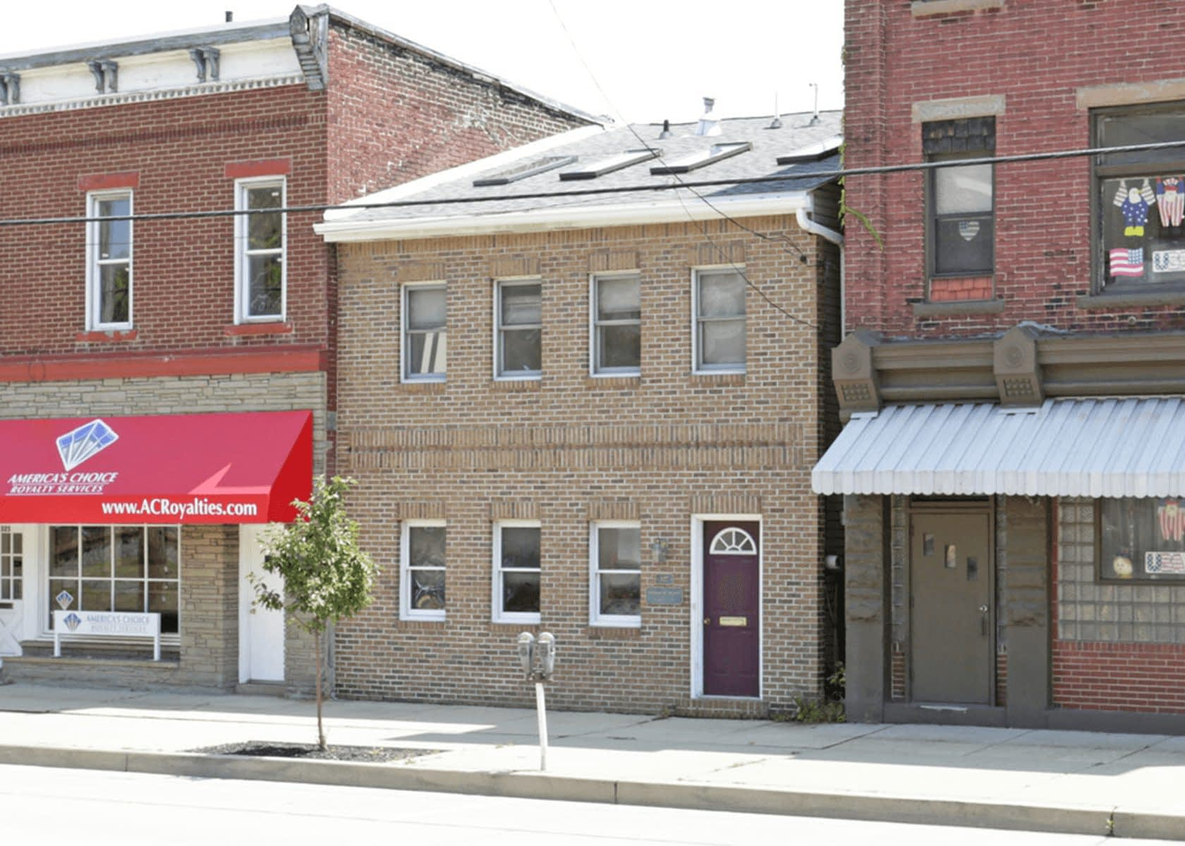 Exterior of 327 West Main Street: Two story brick building