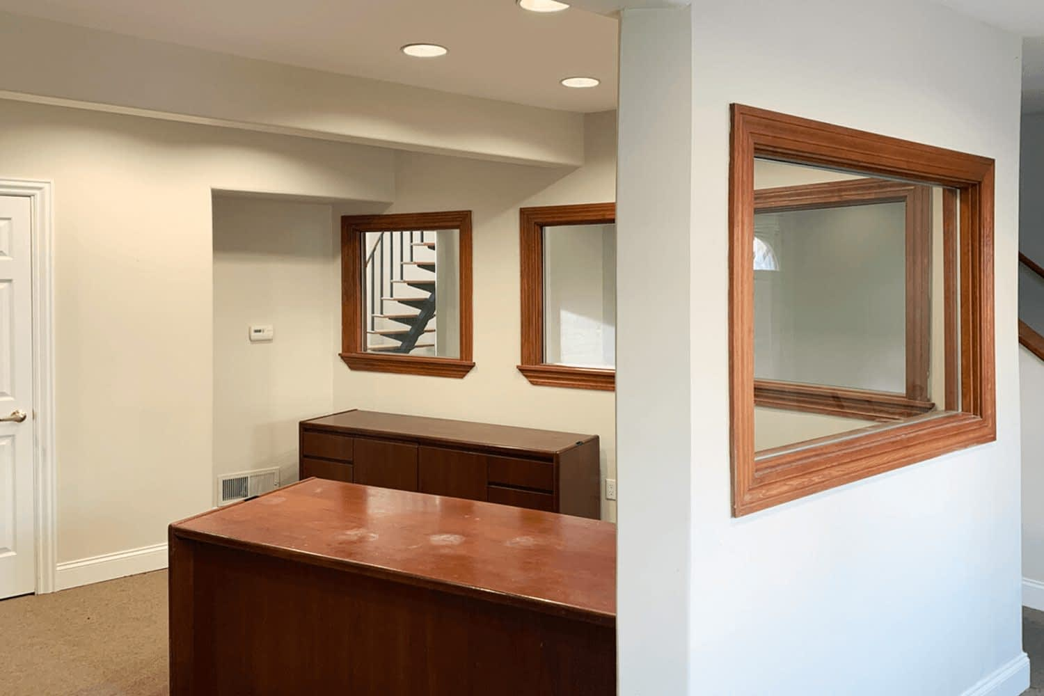 office with windows looking into other rooms
