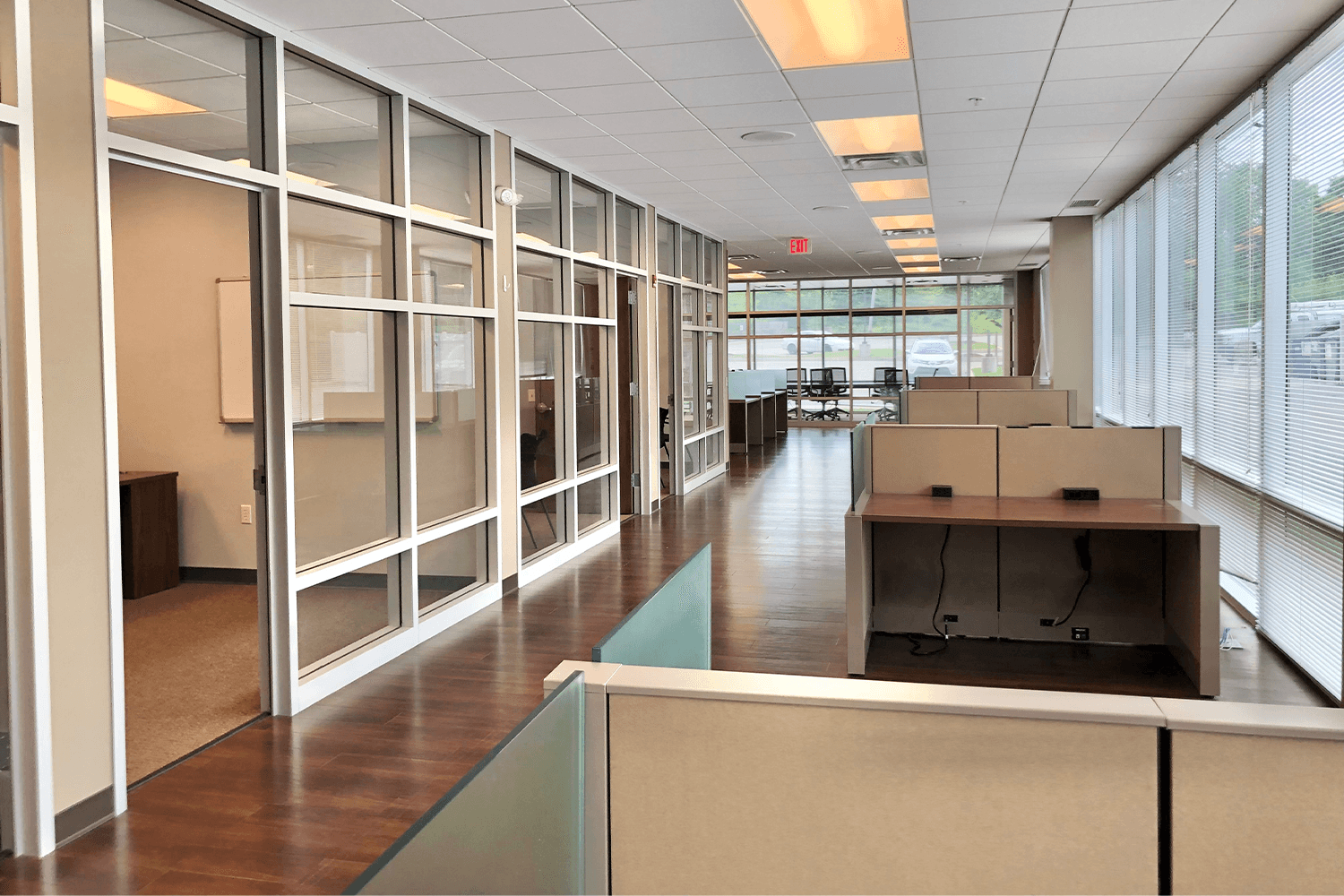 Hallway with cubicles and glass walls