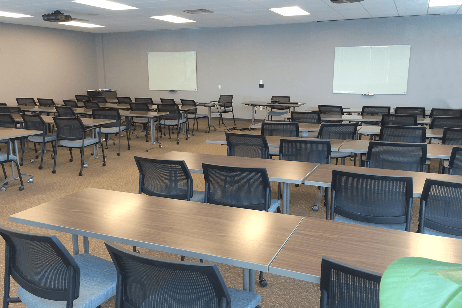 rows of desks and desk chairs