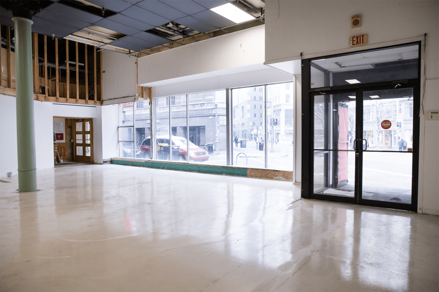 Inside view of the front of the store looking out large windows to the street