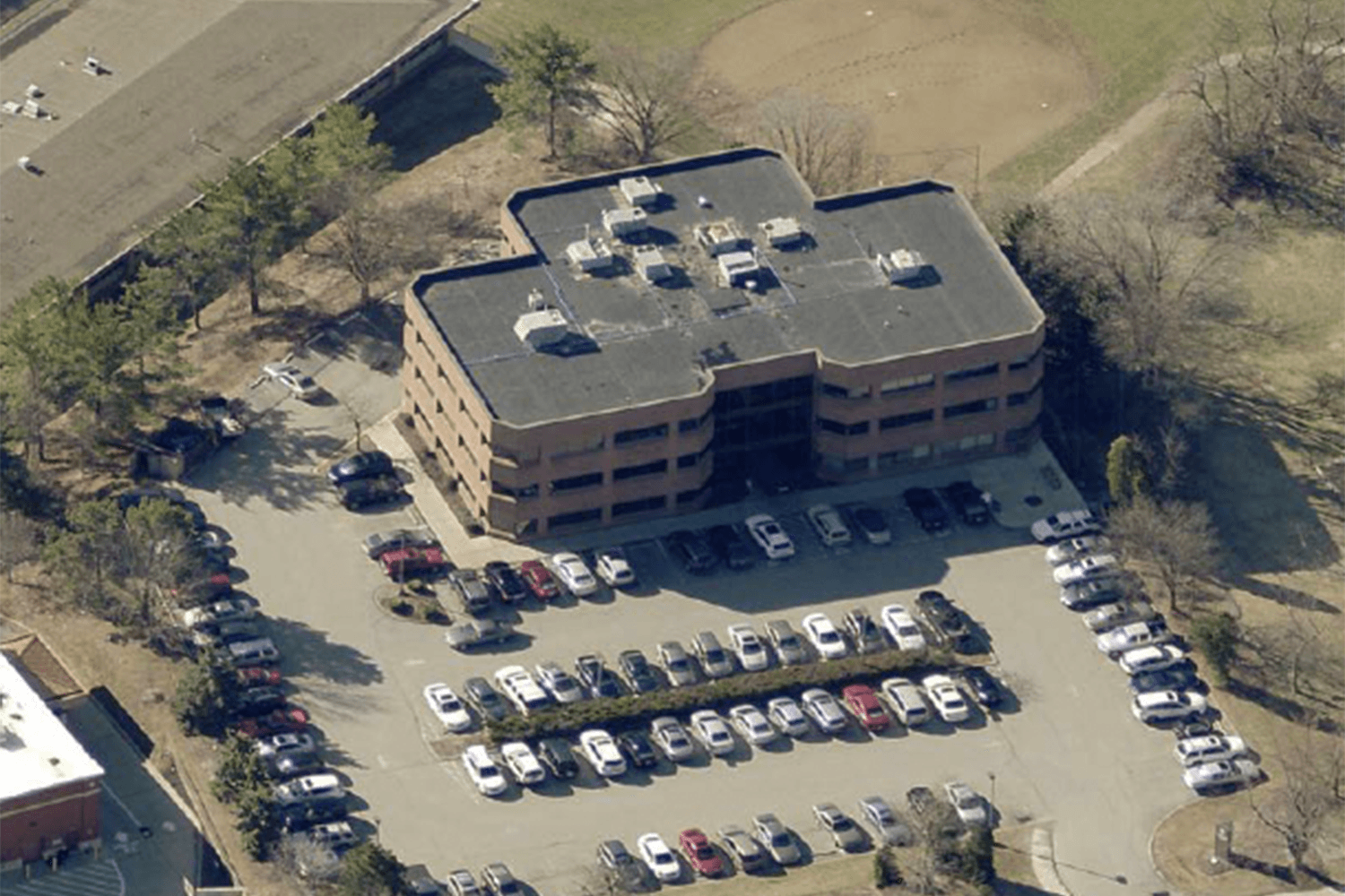 aerial view of 1145 Bower Hill Road, a three-story brick building