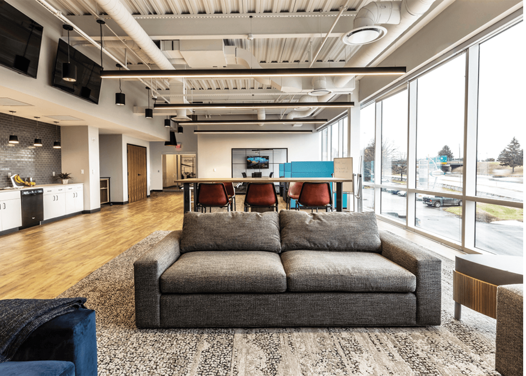 collaborative workspace with a café, couches, and tables
