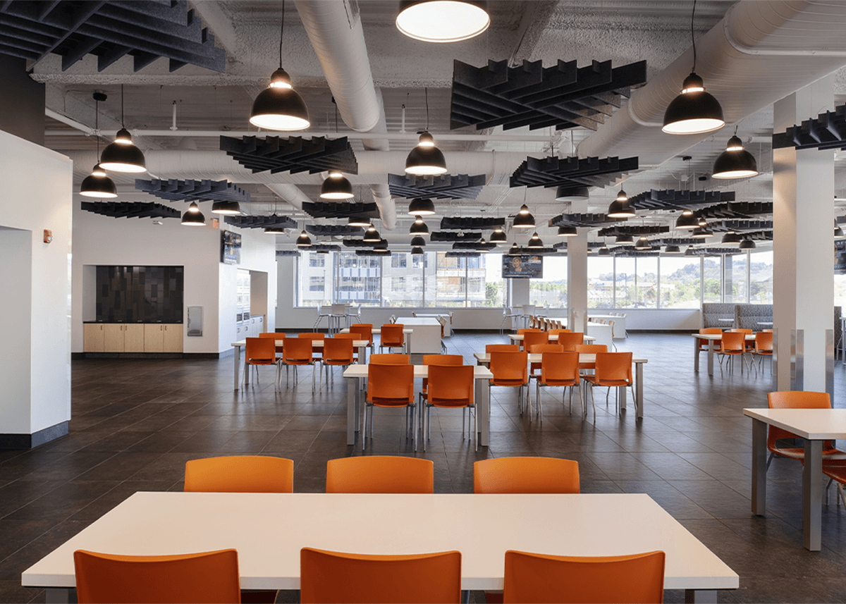 large café with white tables and orange chairs
