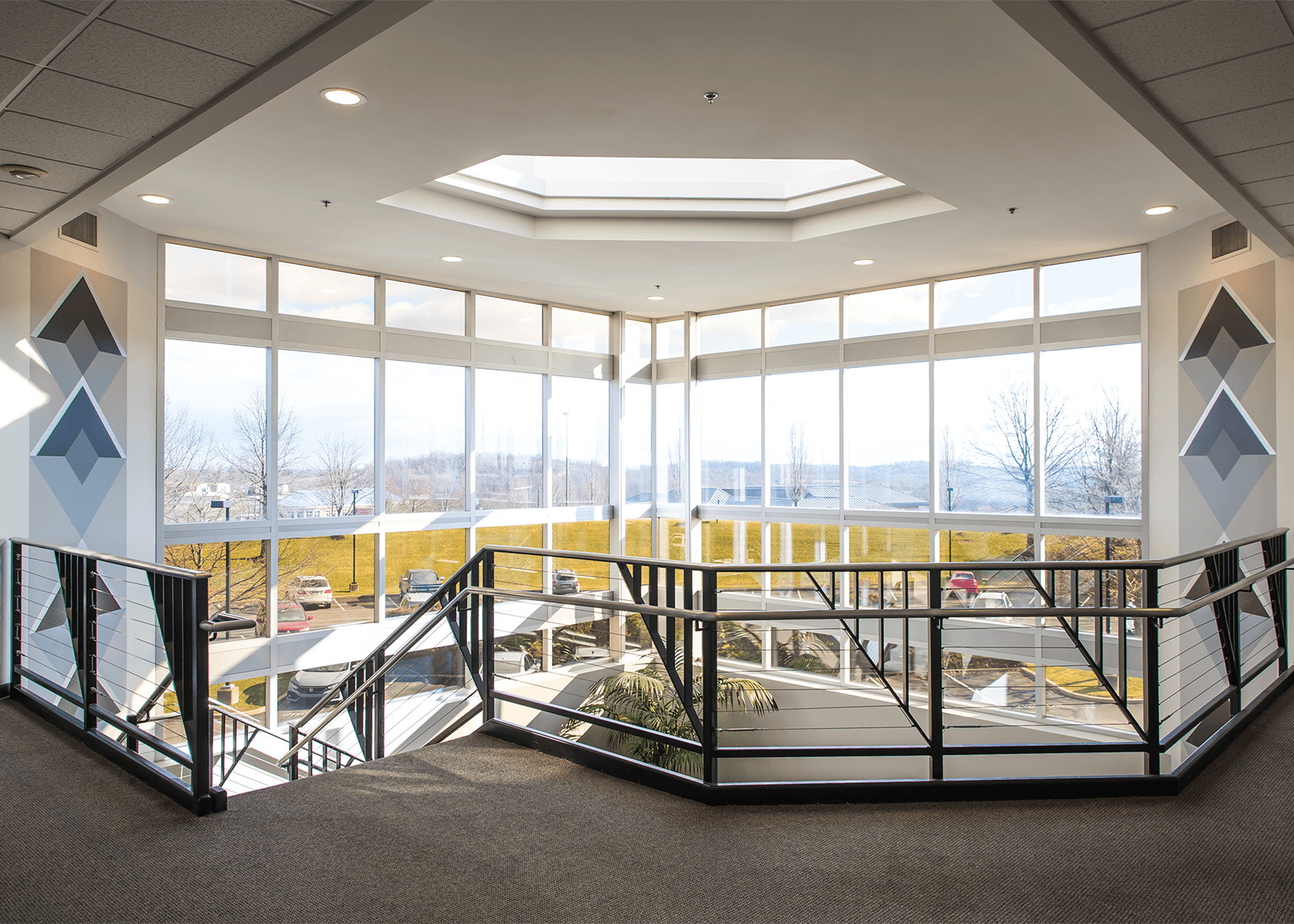 Stealth technology center interior multi-level lobby with large windows