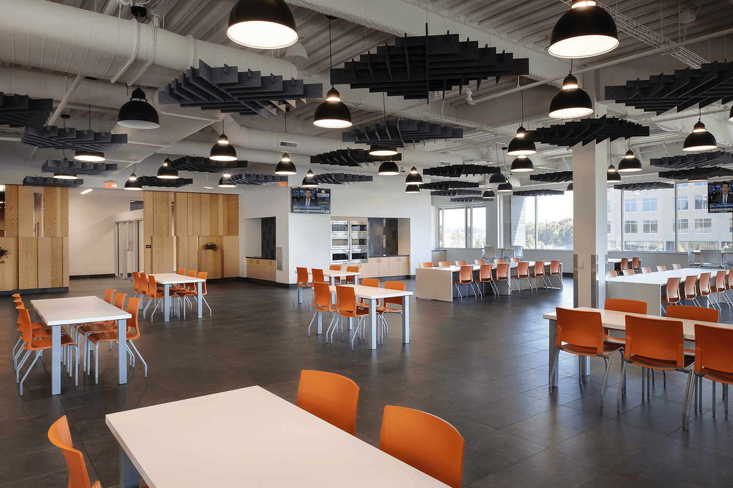 large café with white tables and bright orange chairs