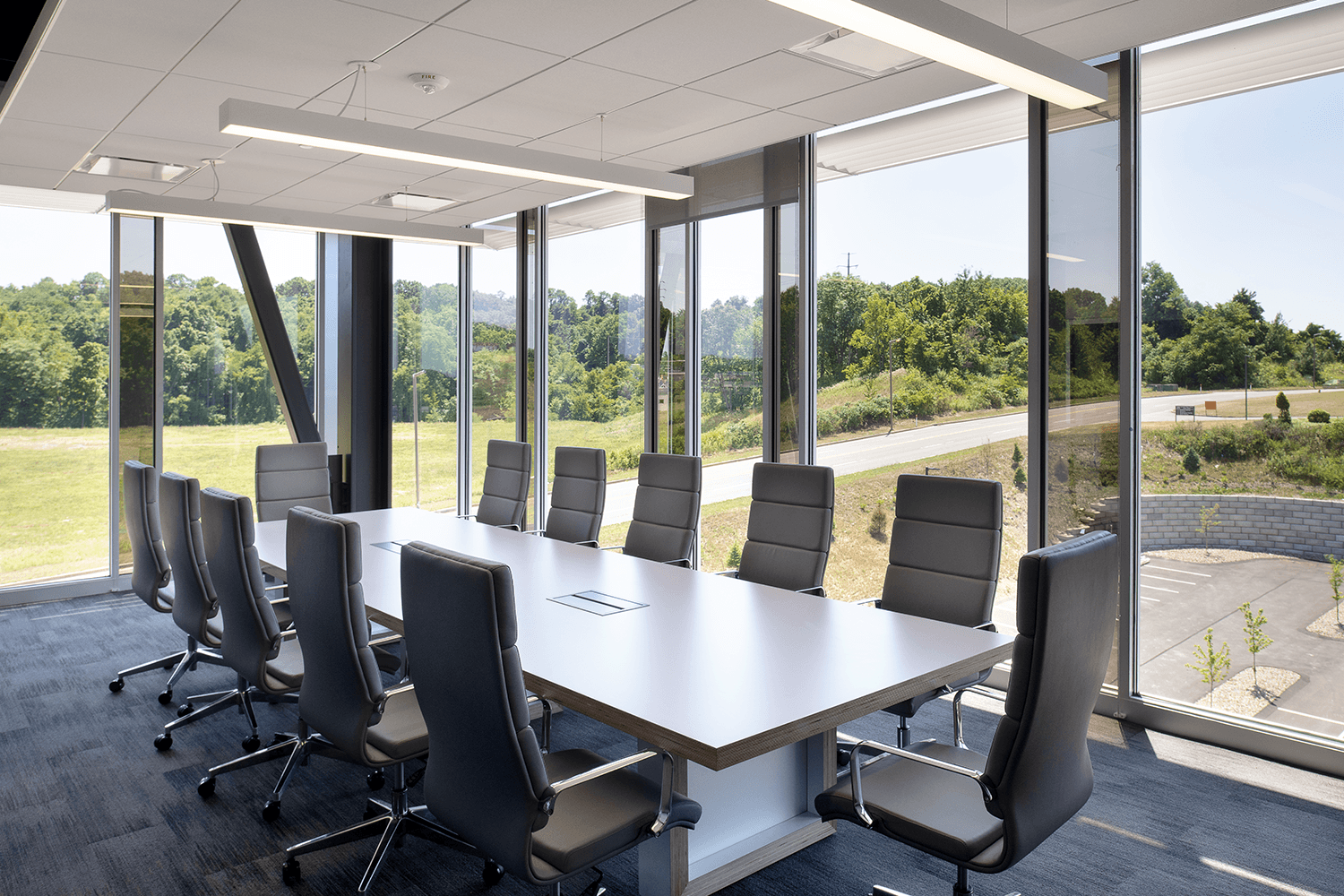 conference room with a table and chairs with large floor-to-ceiling windows