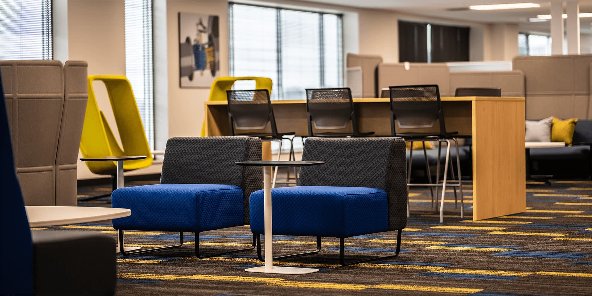 large open office space bright colored furniture
