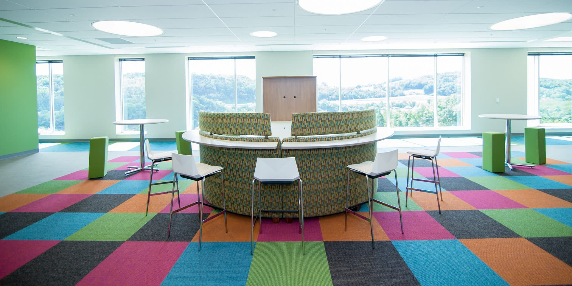 colorful collaborative office space with abstract furniture