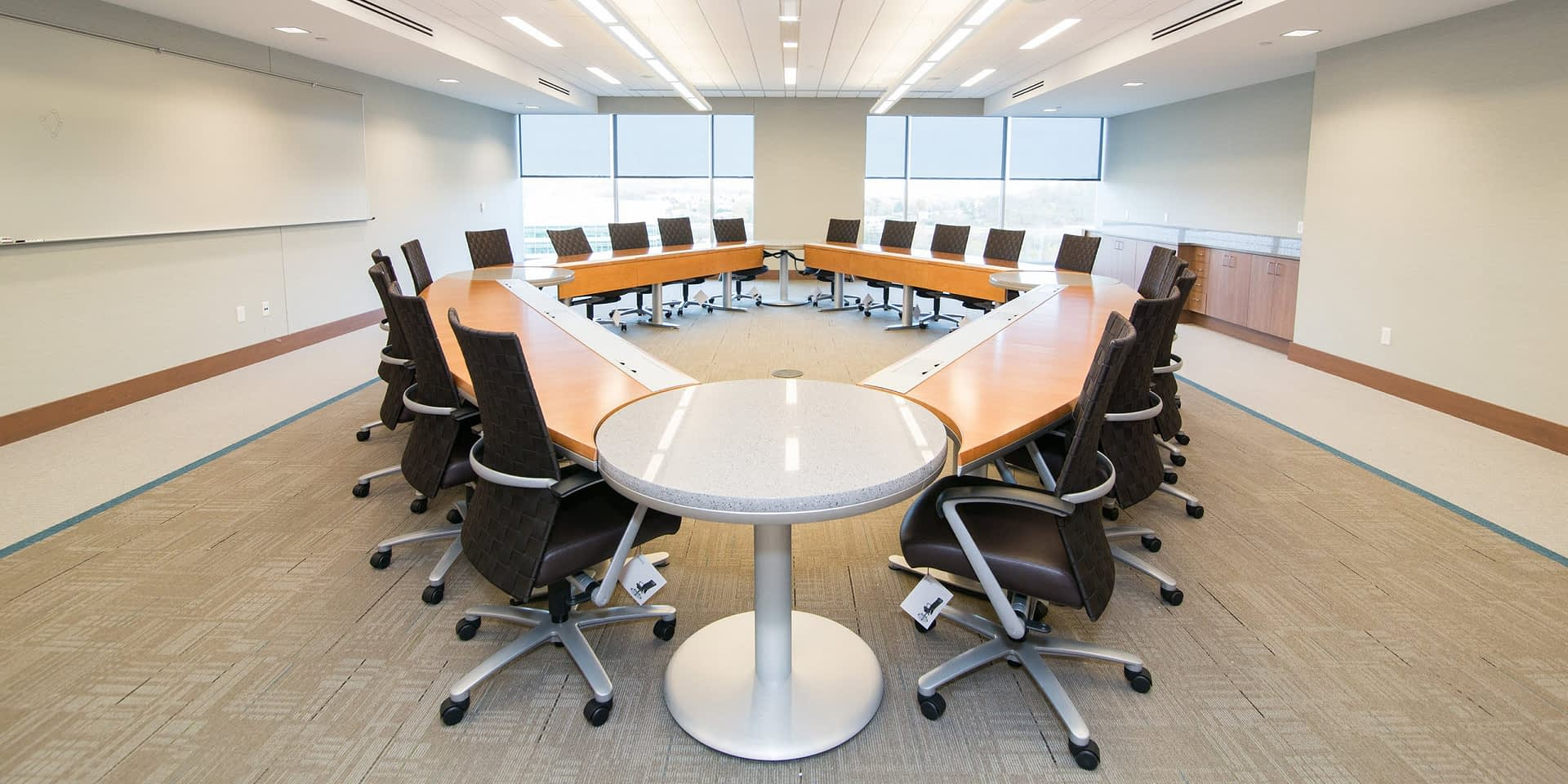 large conference table with many desk chairs around it
