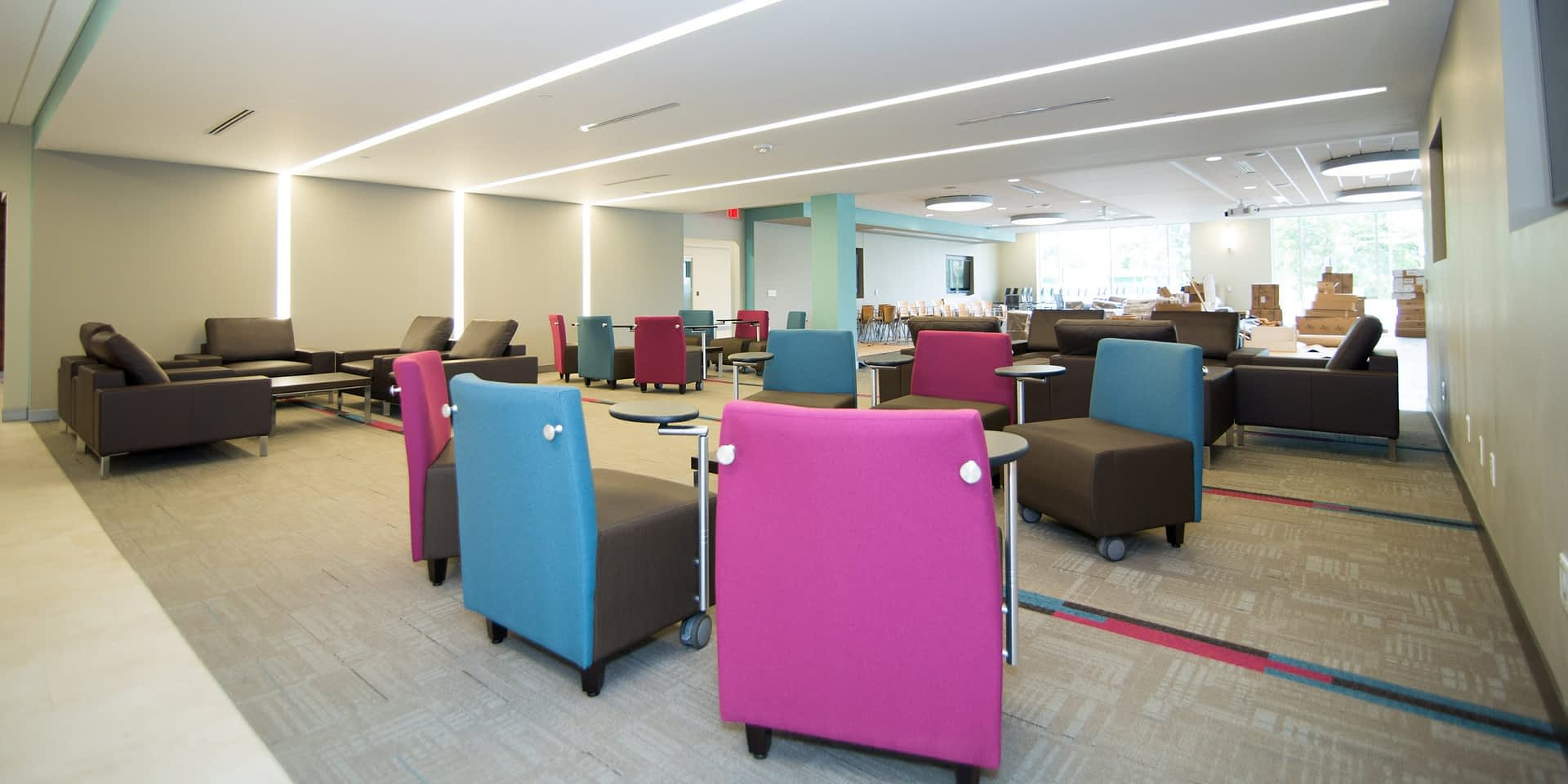 blue, pinks, and gray furniture in a collaborative office space