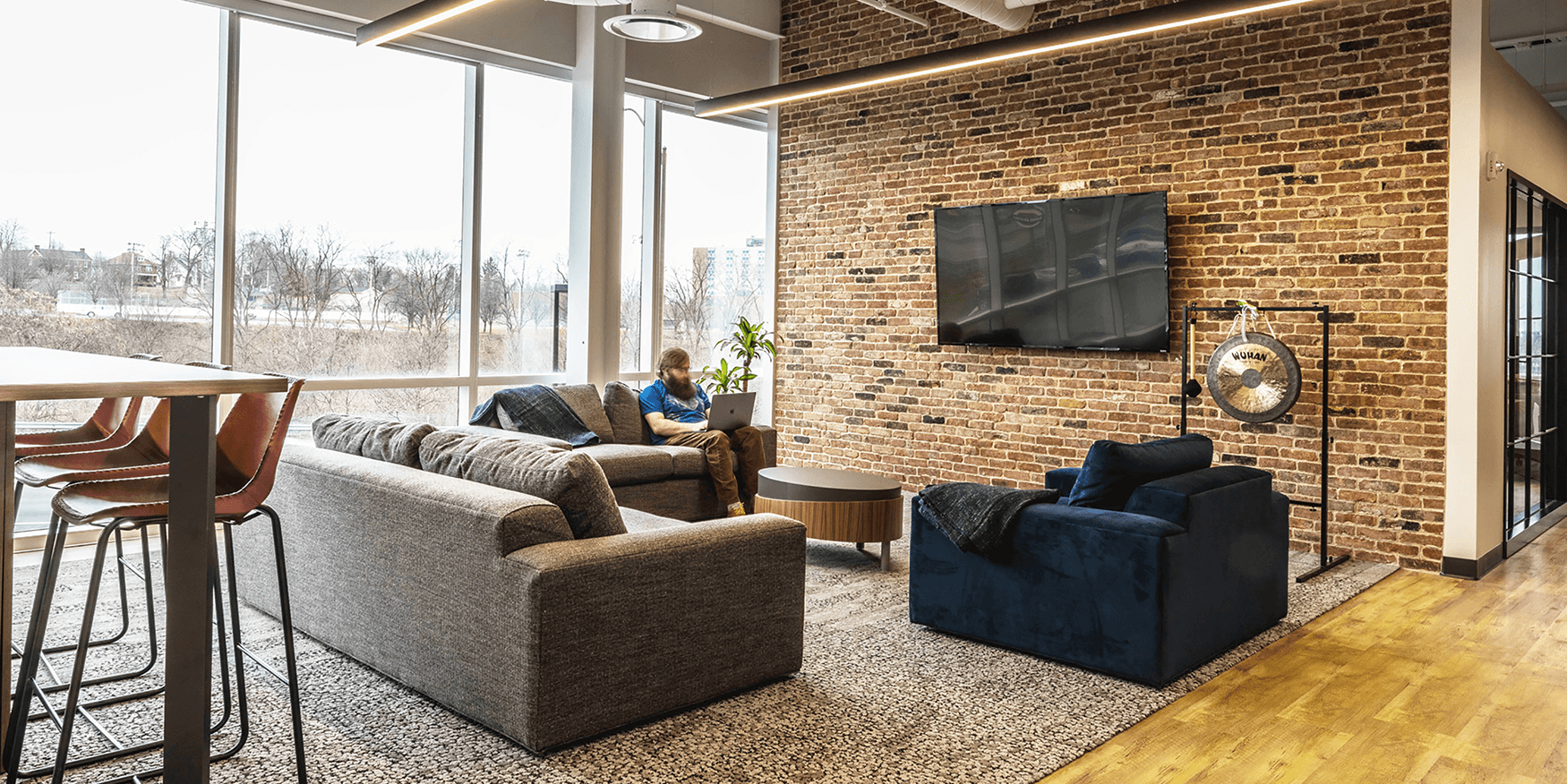 collaborative workspace with three couches