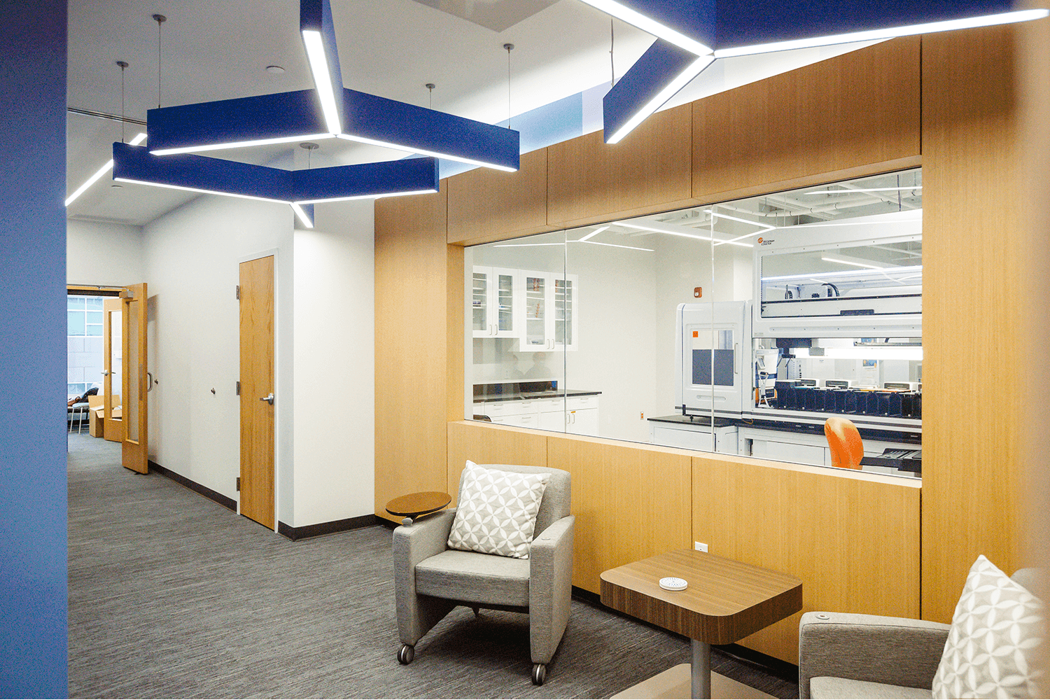 lobby area with two chairs and a window into the bio lab