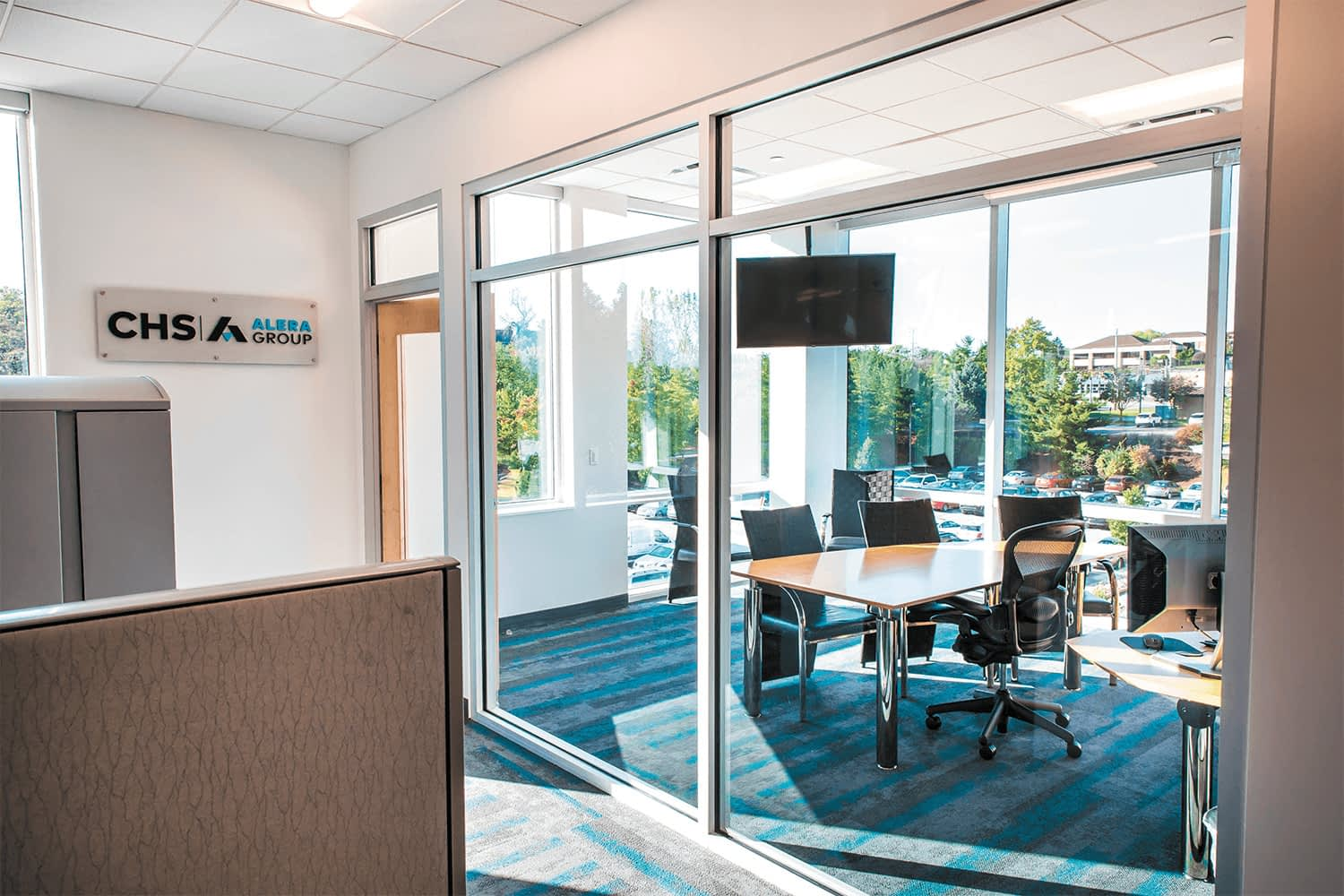view through a glass wall into a conference room