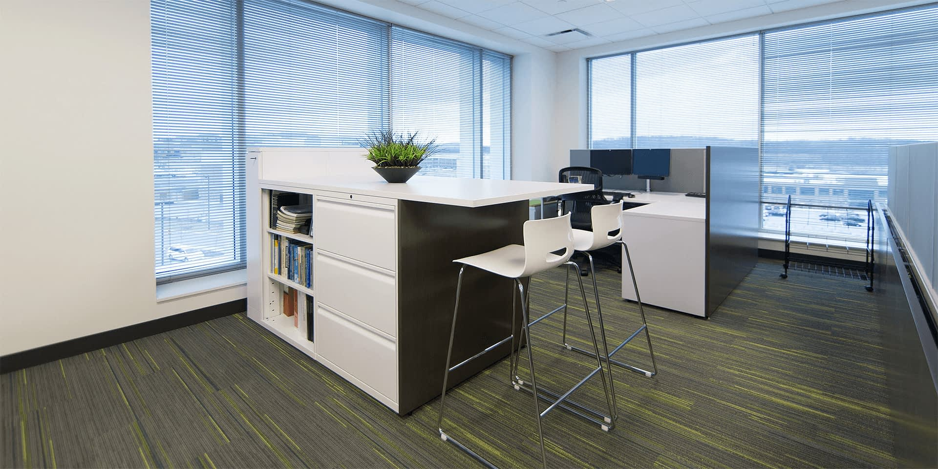 workspace with a high-top tables and a cubicle
