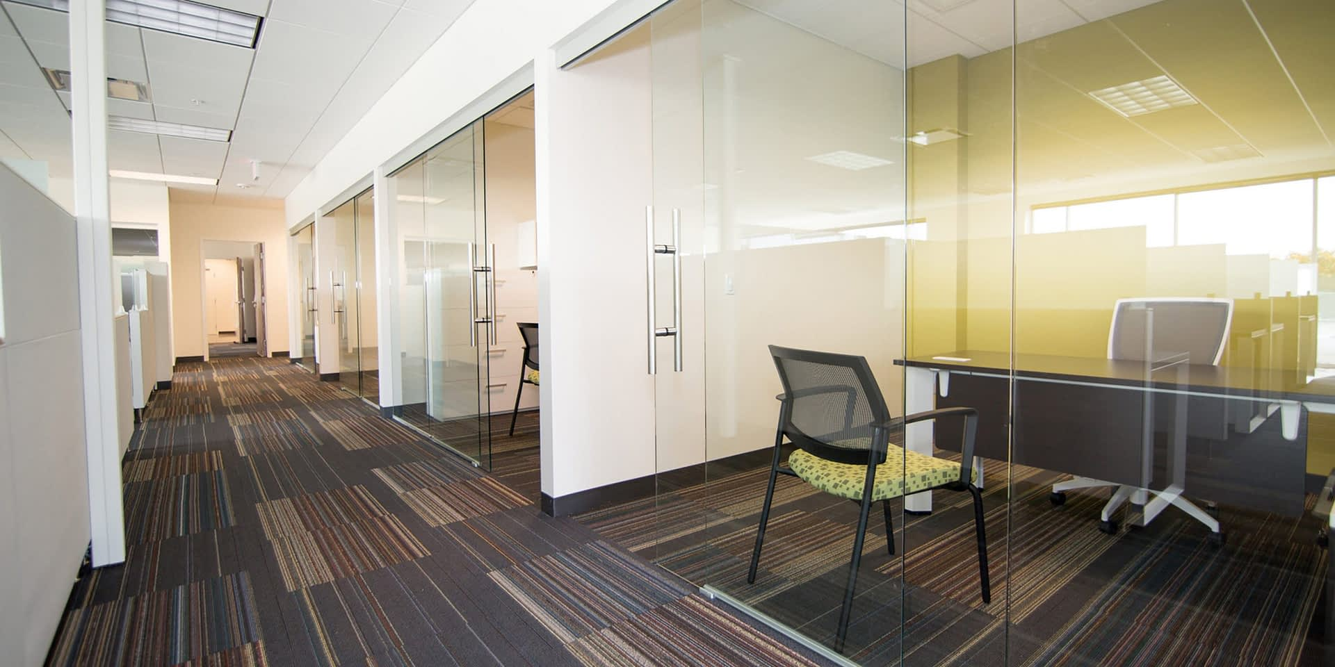 private workspaces with sliding glass doors