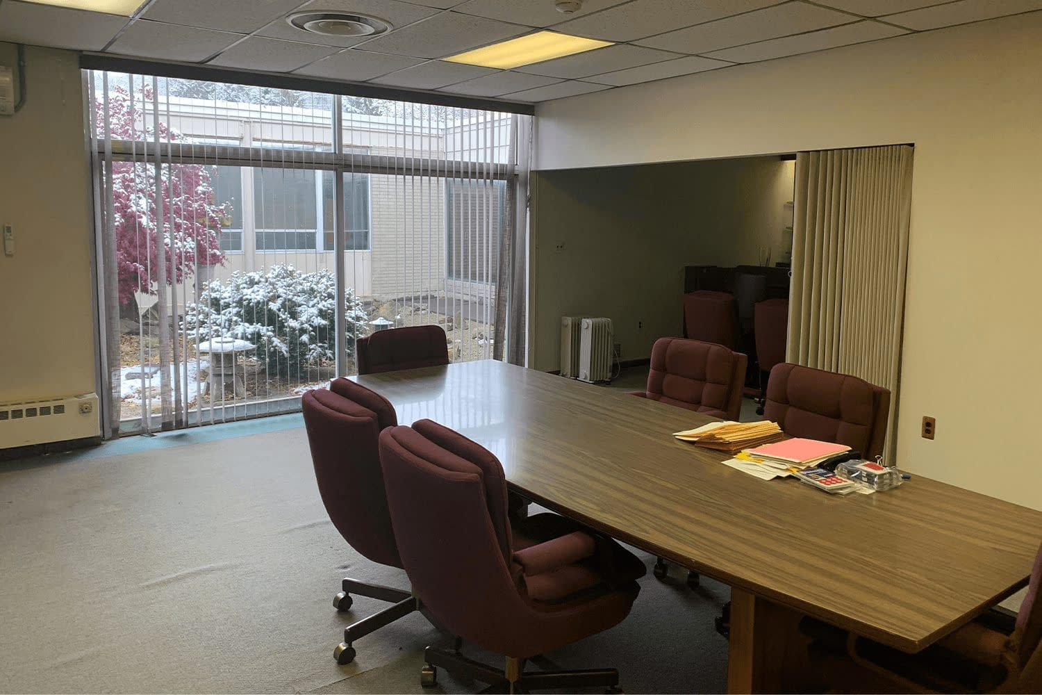 Conference room with a table and chairs and floor-to-ceiling windows