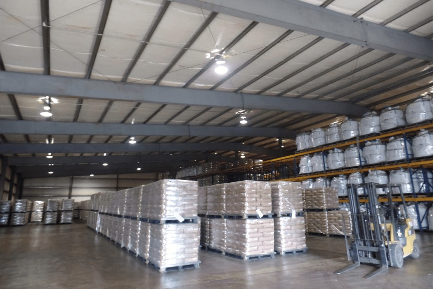 Interior of garage/storage building with palettes of packaged products