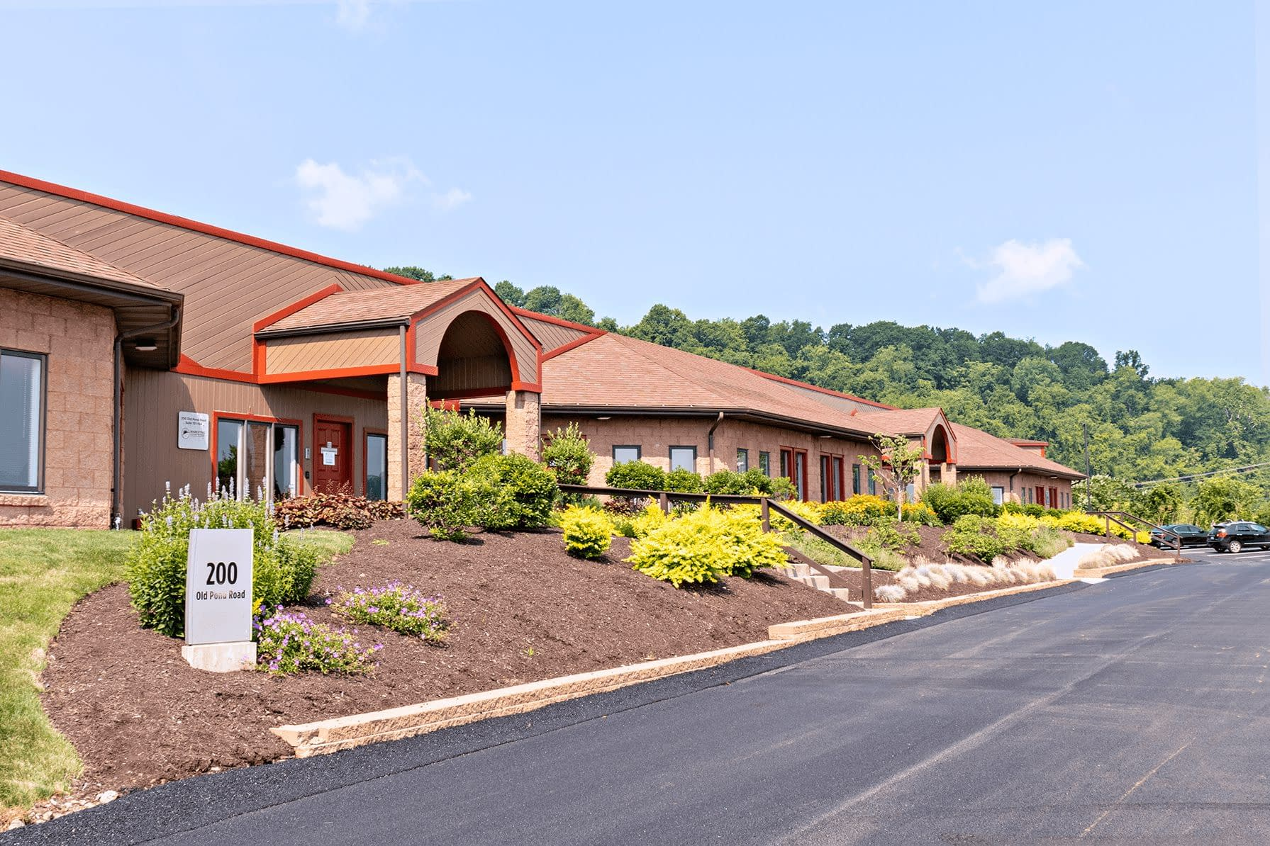 Building at Abele Business Park with newly paved street and well-kept shrubbery