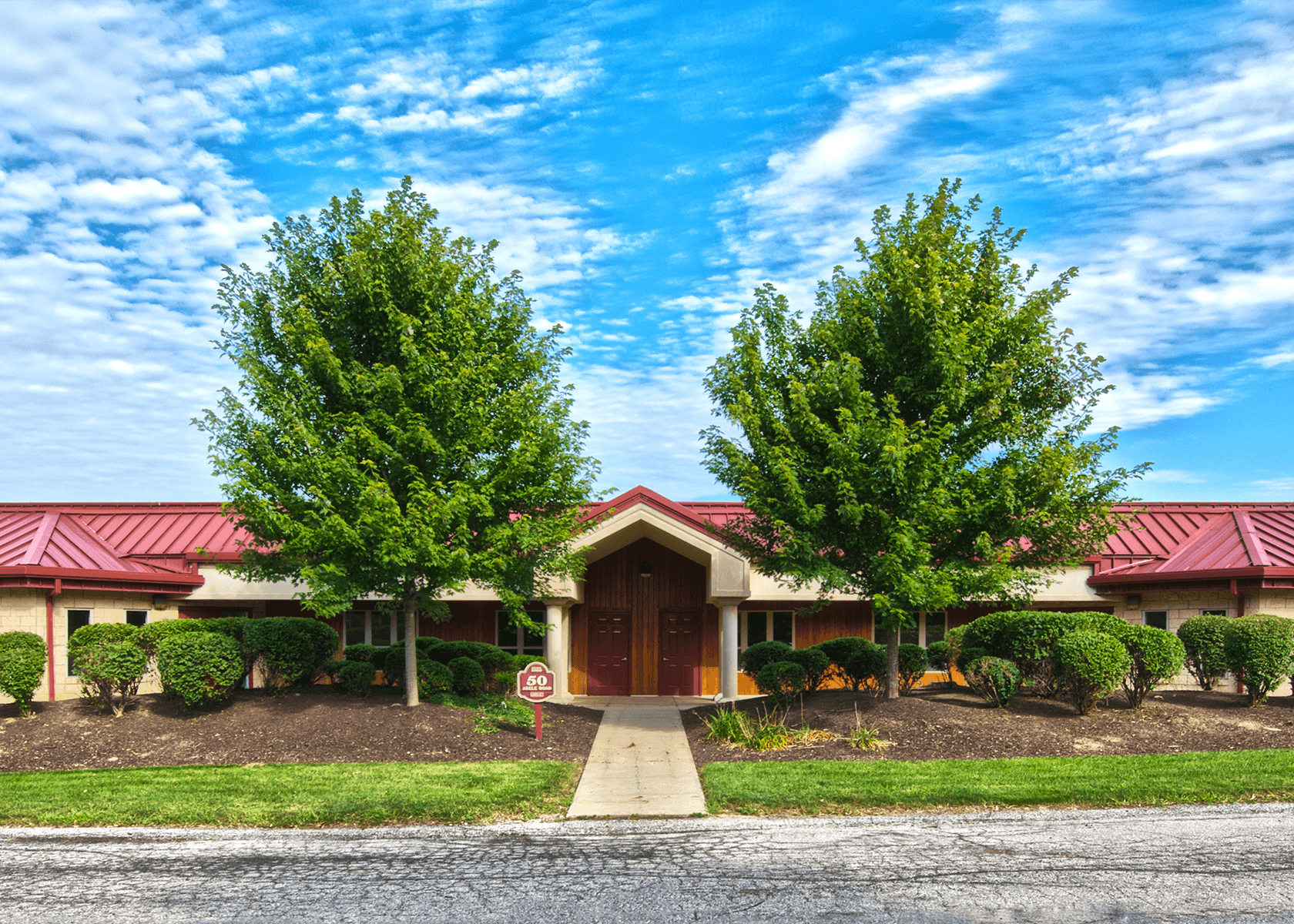 Exterior of a building at Abele Business Park with trees and shrubbery