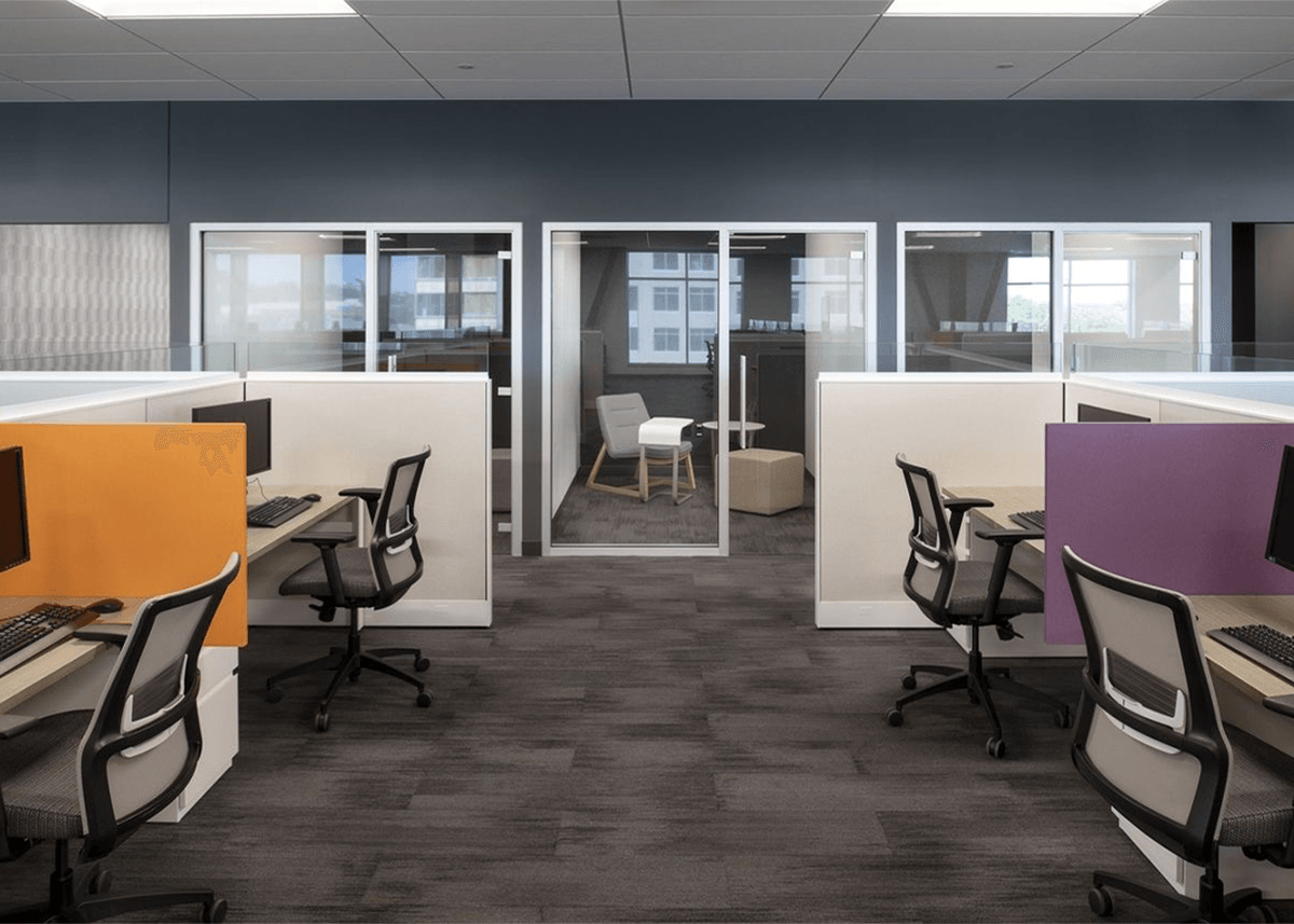 Cubicles with bright orange and purple accent walls