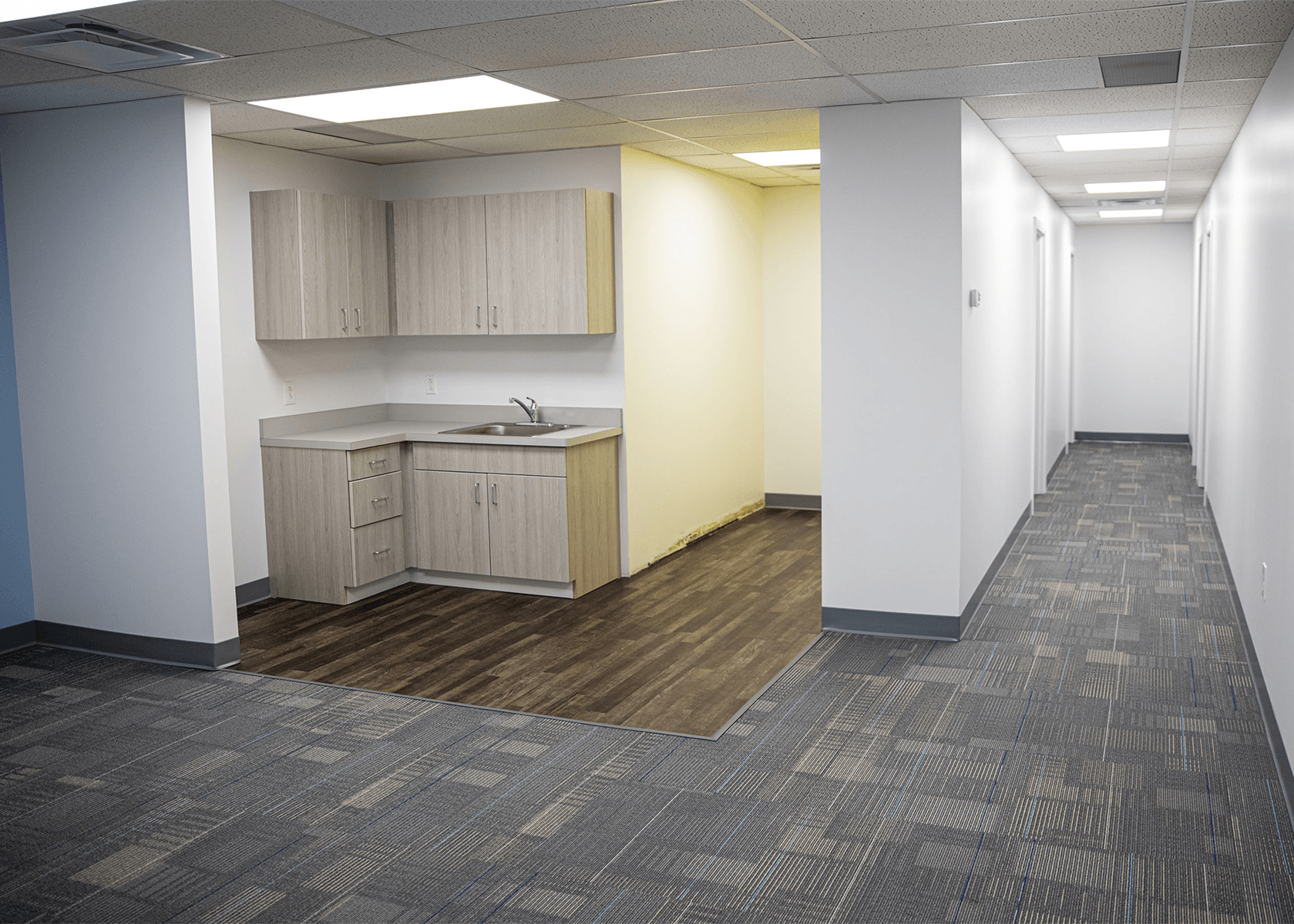 Break area and hallway inside of an office suite
