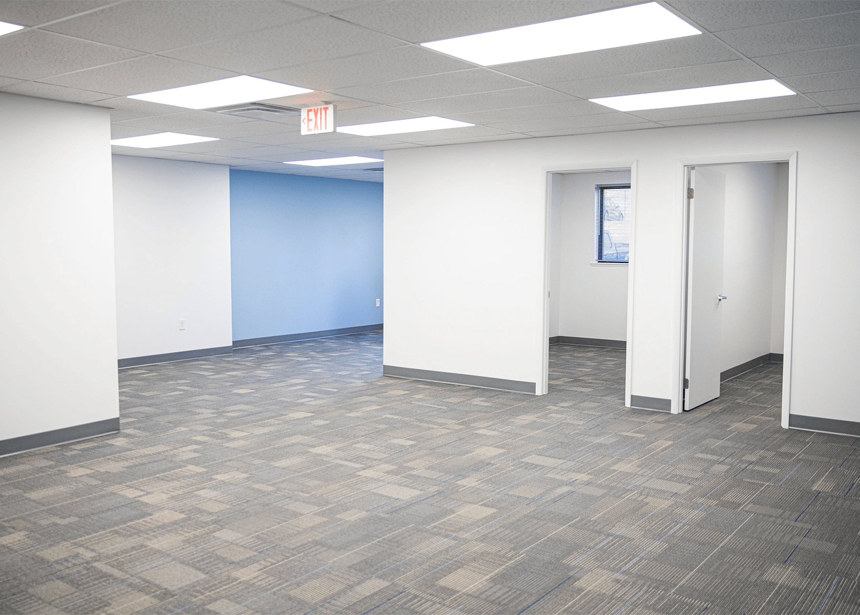 interior office with bright white walls with a blue accent wall