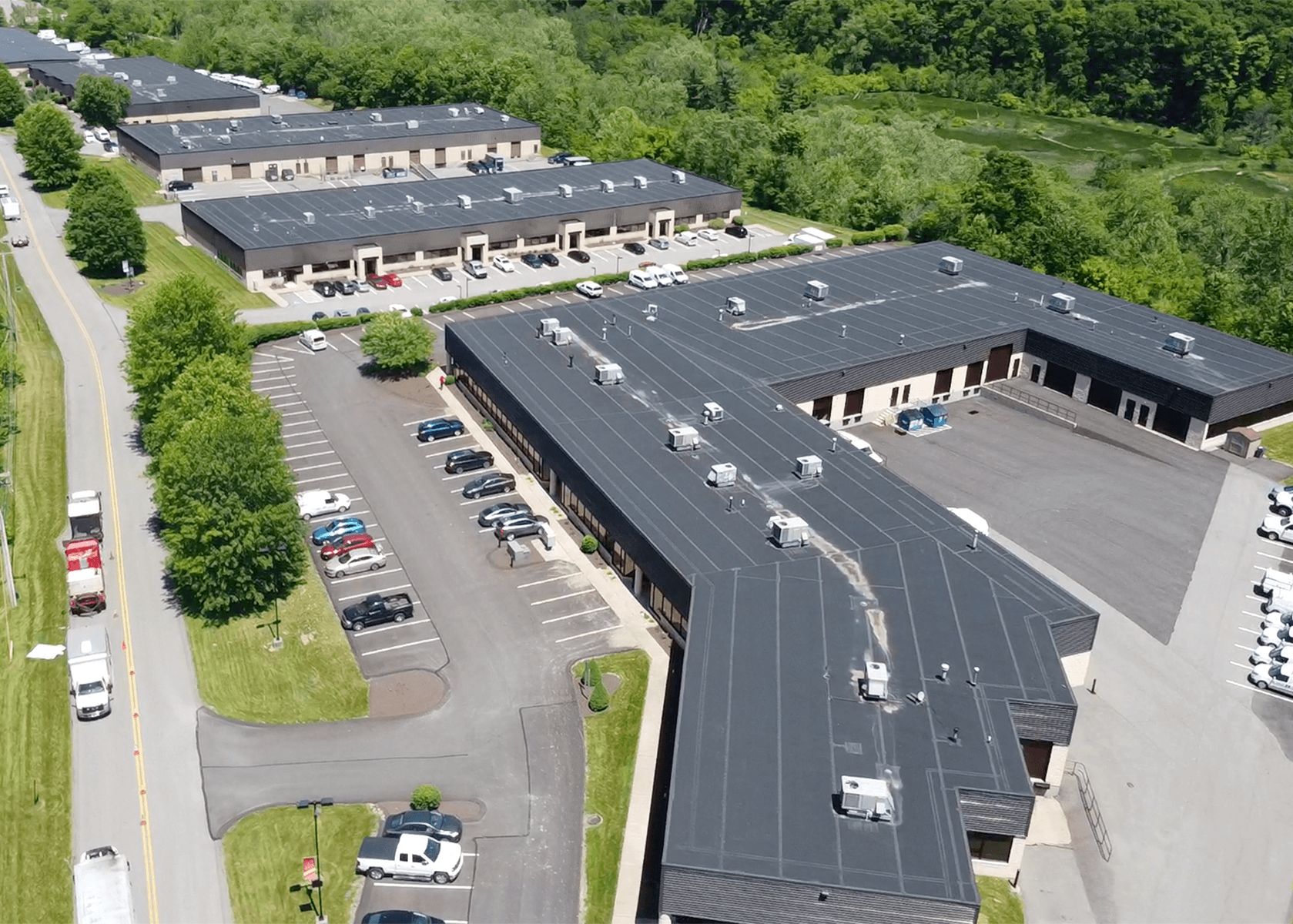 Aerial view of five buildings at Bursca business park