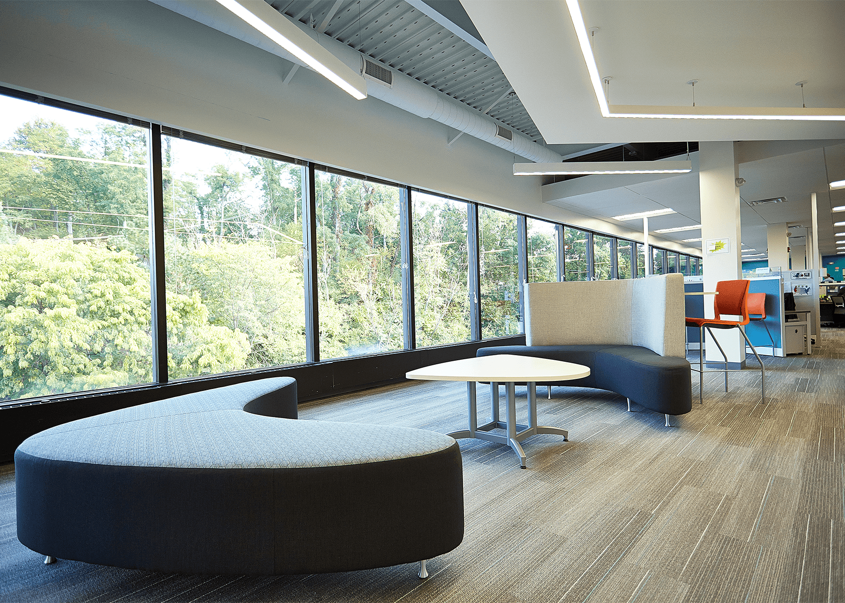 Collaborative workspace with modern abstract couches and table