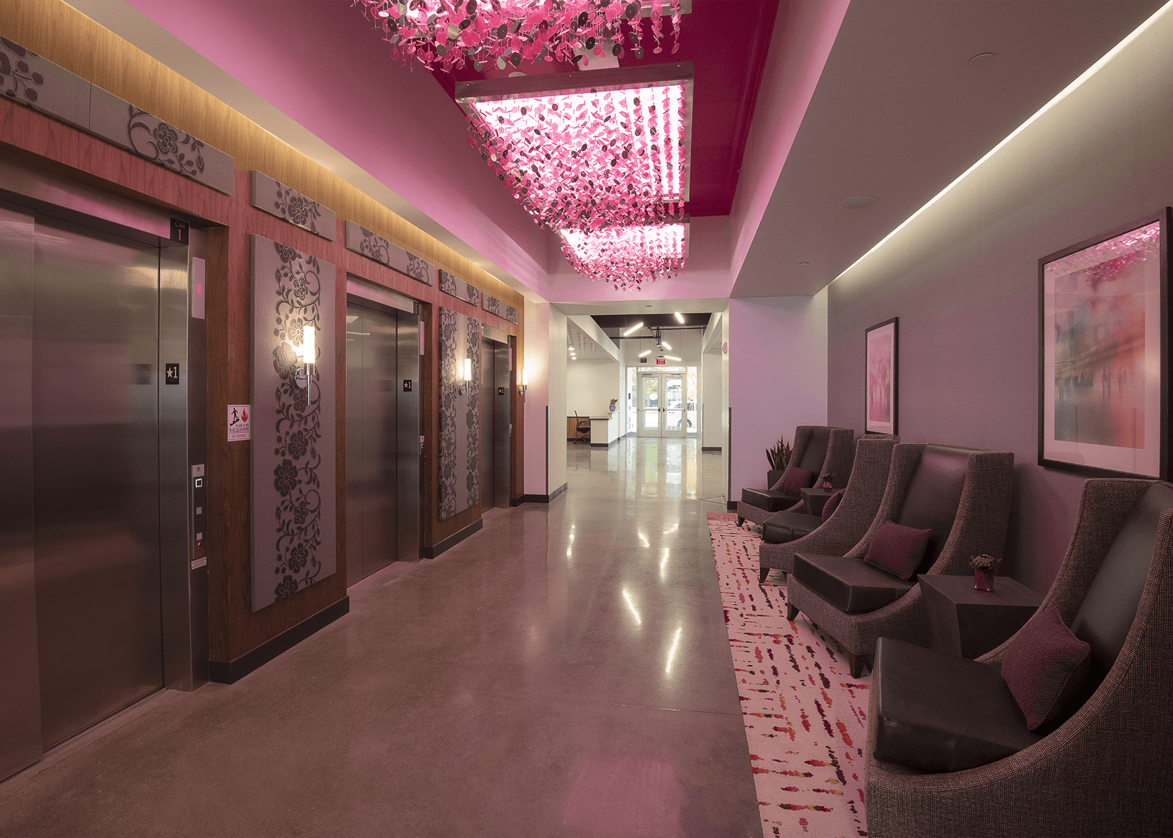 Hallway with chairs and and pink lighting