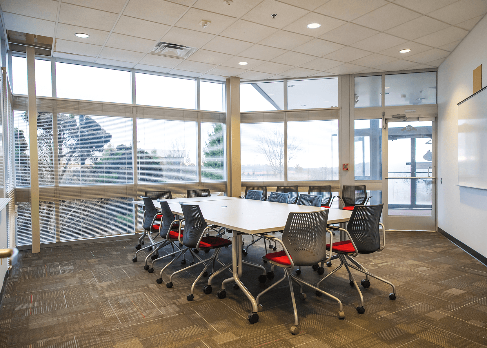 conference table with large floor-to-ceiling windows
