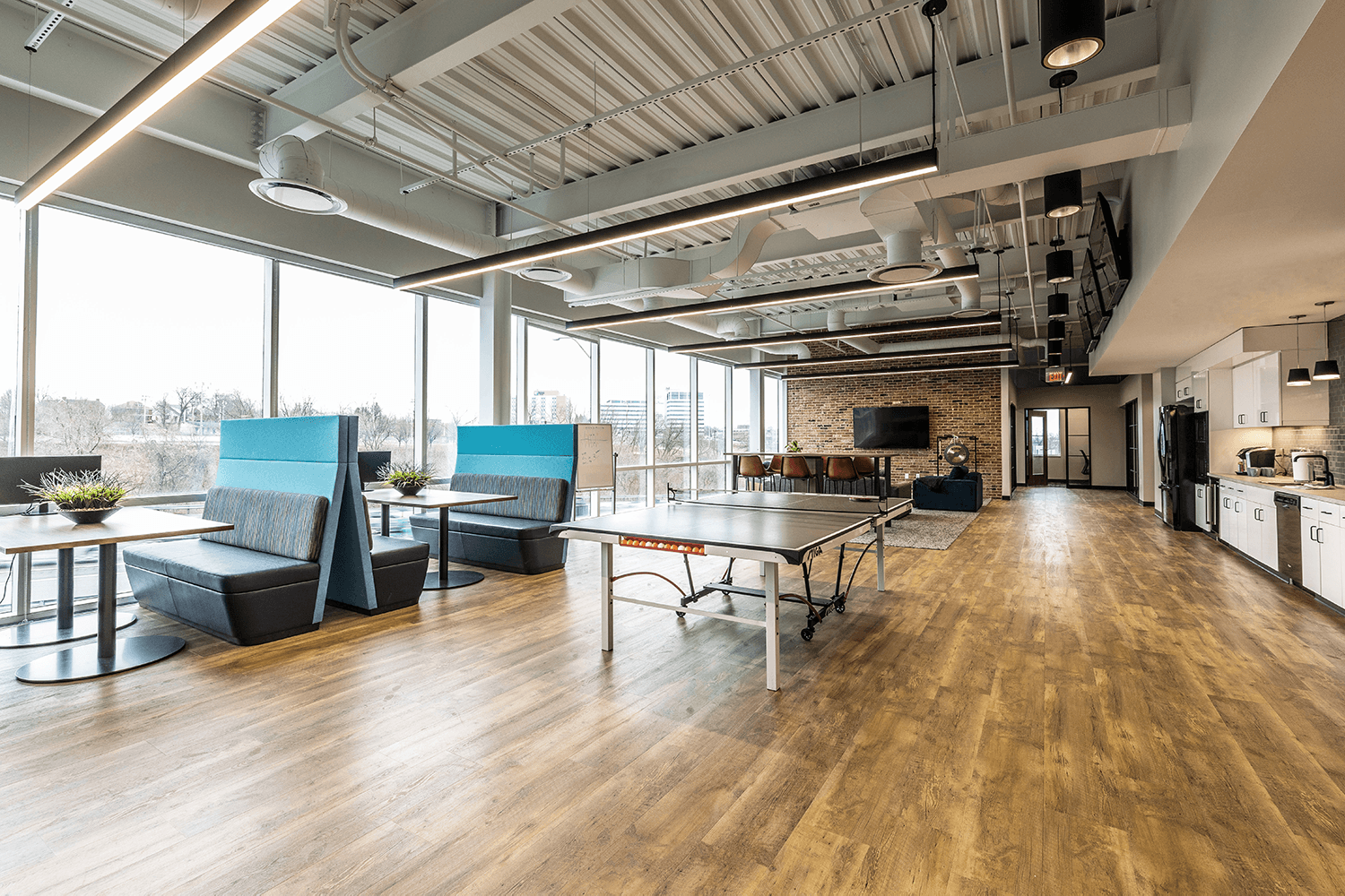 collaborative office space with booths and a ping pong table