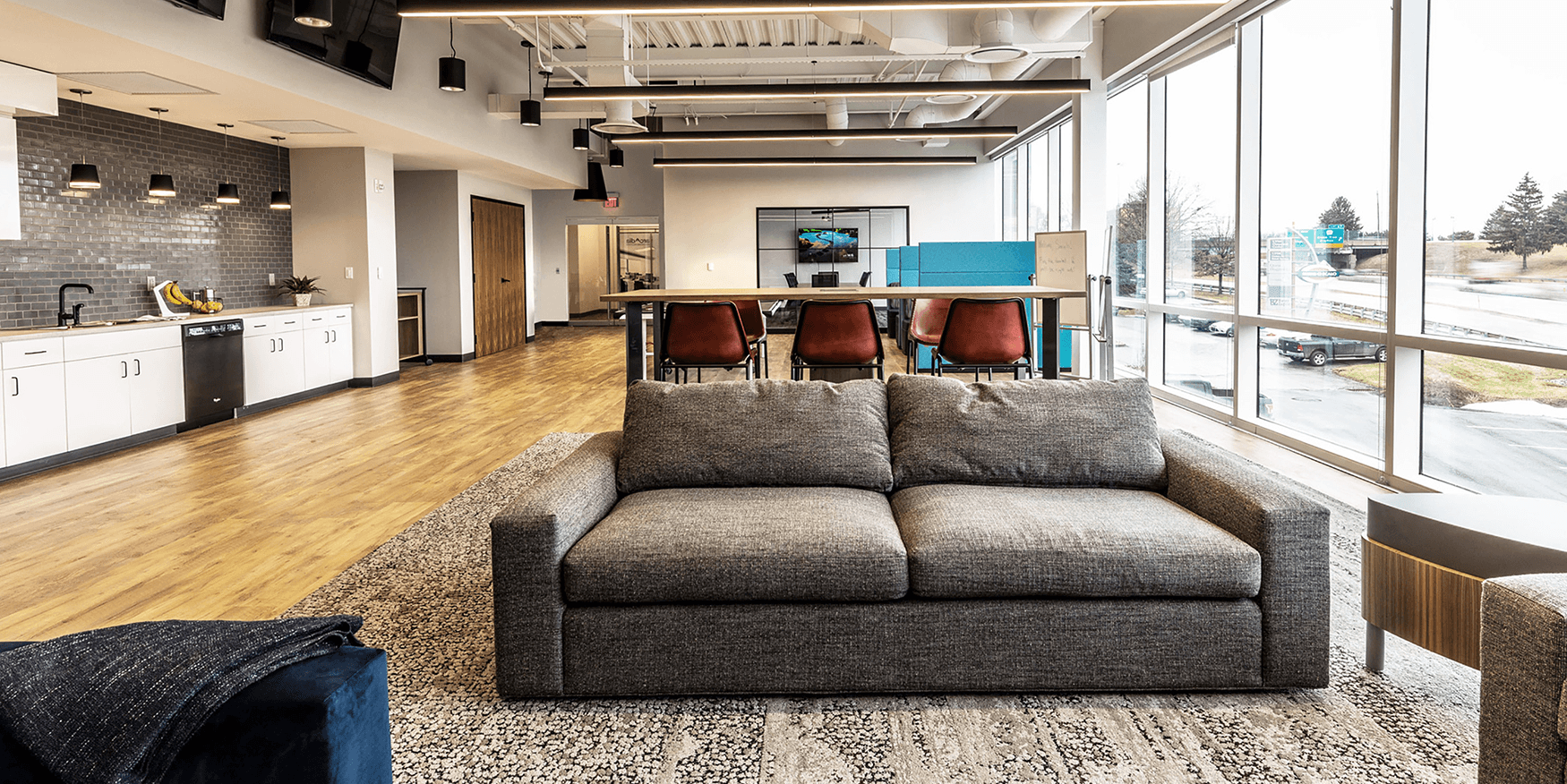 gray couch in collaborative office space