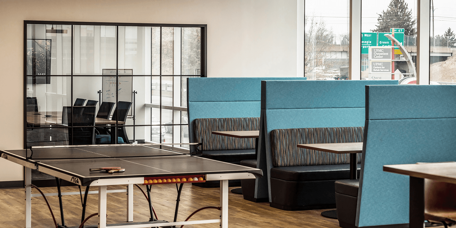 collaborative workspace with ping pong table and booths