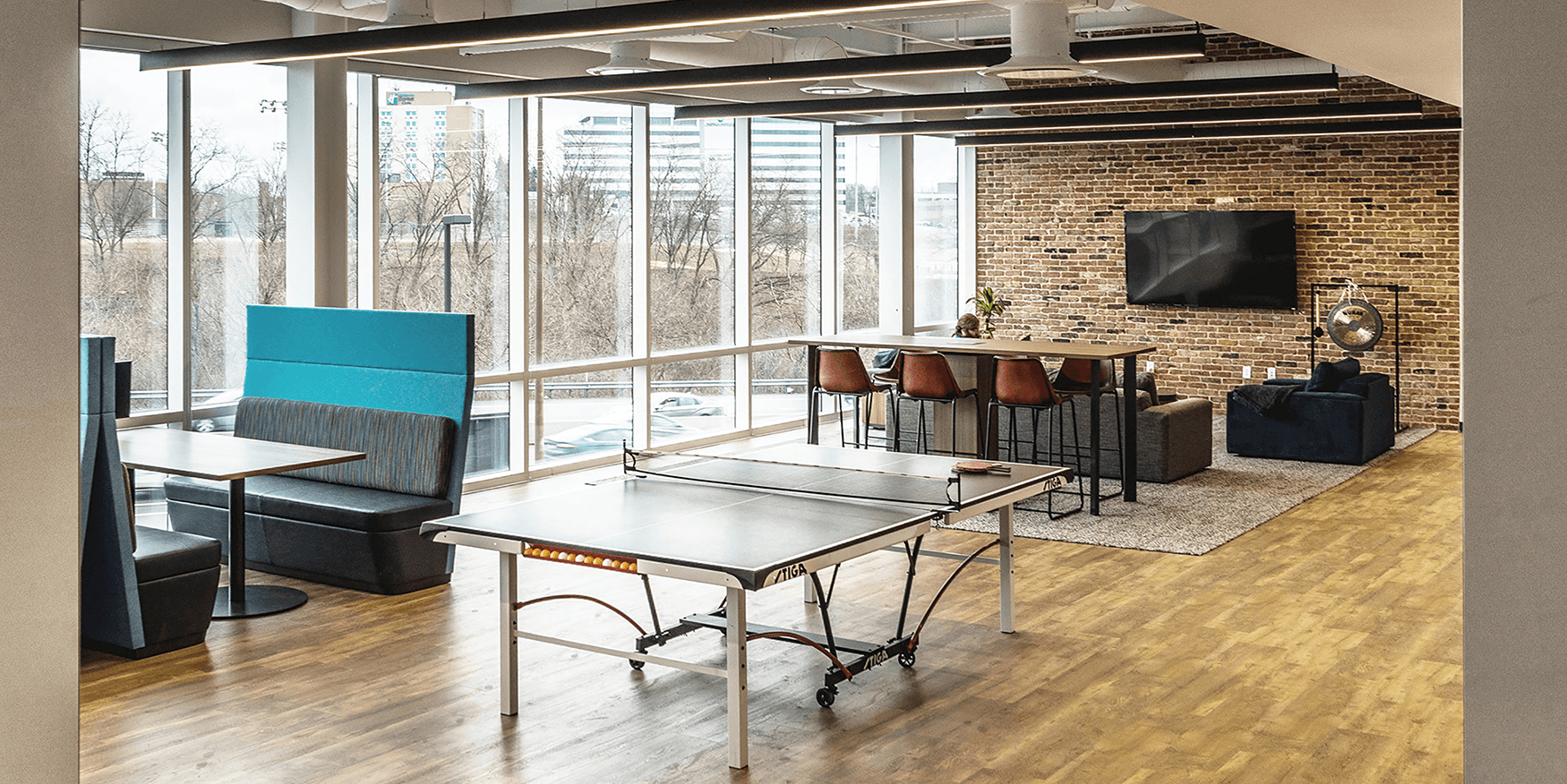 collaborative workspace with ping pong table and high-top table
