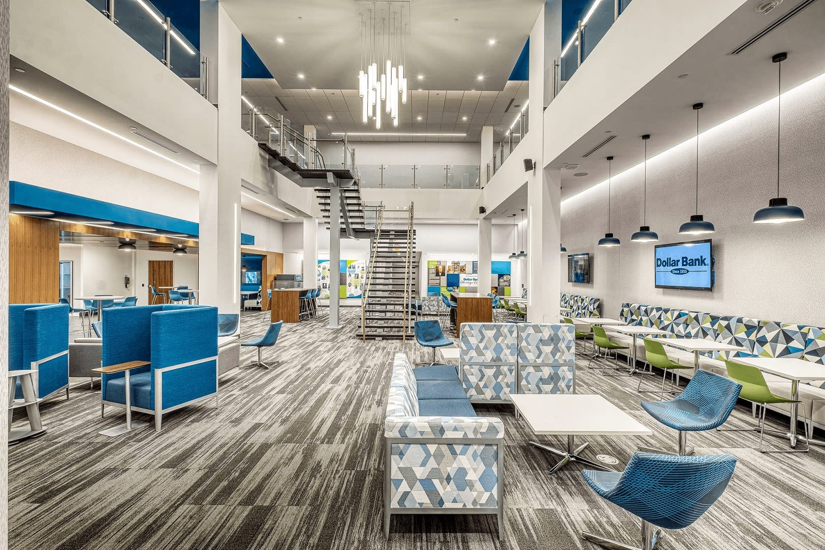 Interior build-out of Dollar bank with blue chairs and gray carpet