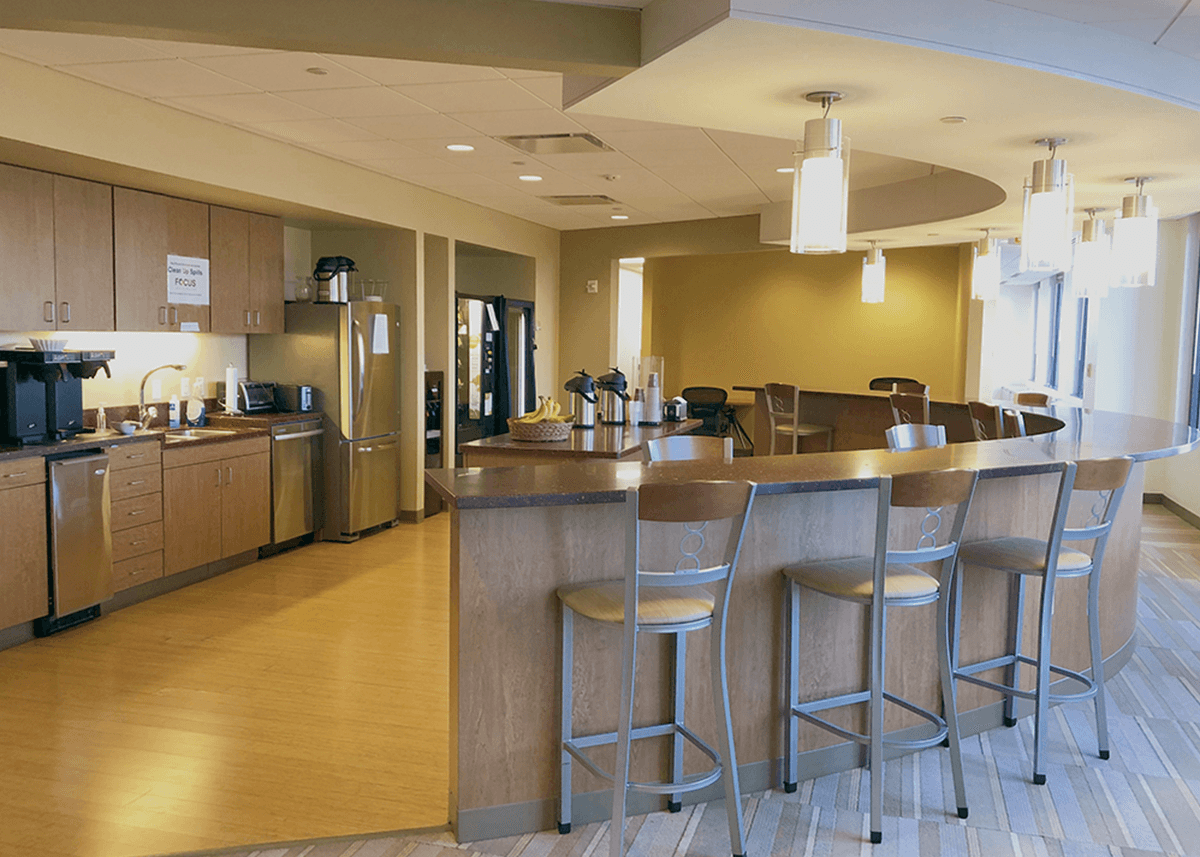 Café with round high-top bar and chairs