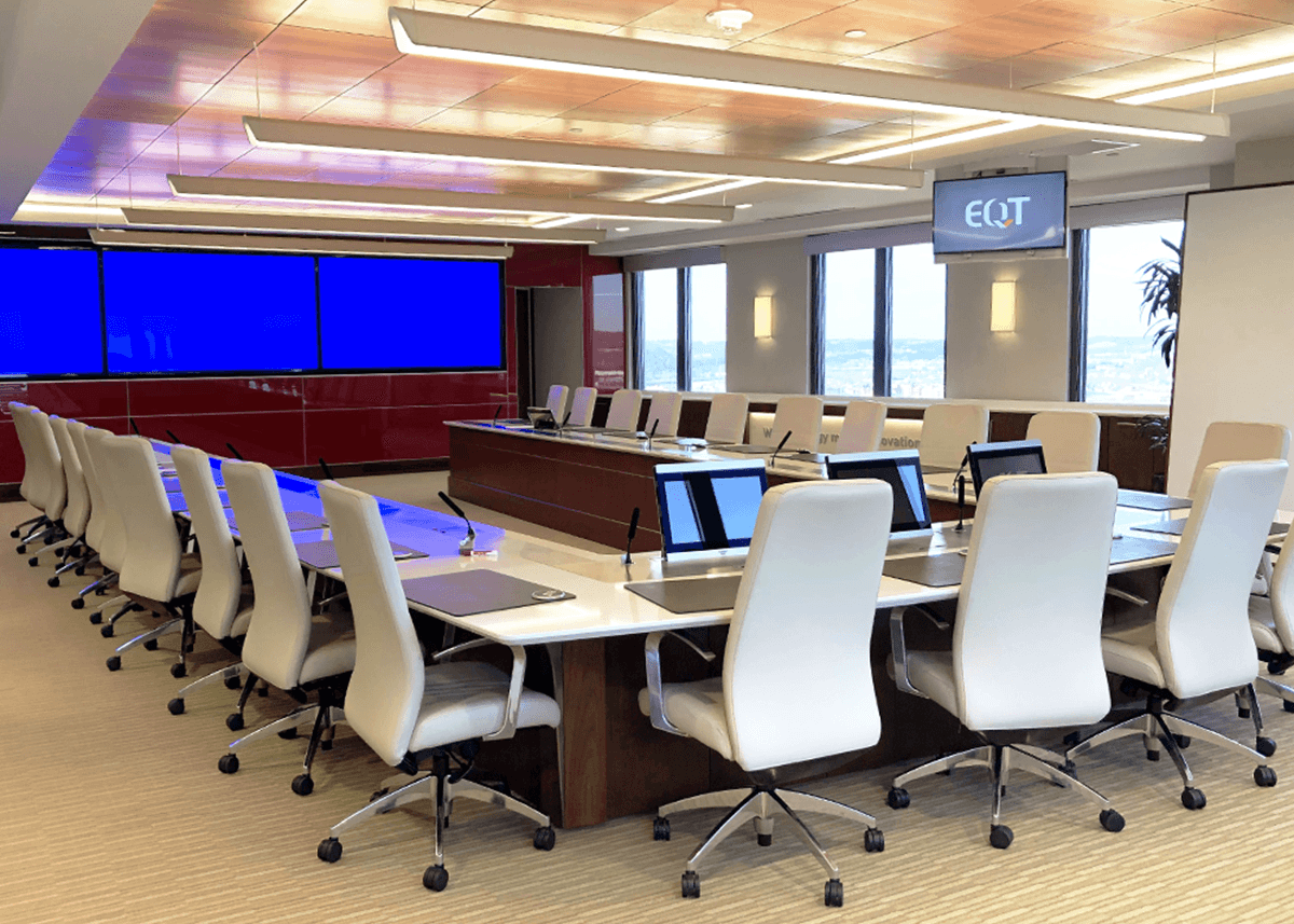Conference room with TV displays and large U-shaped conference table